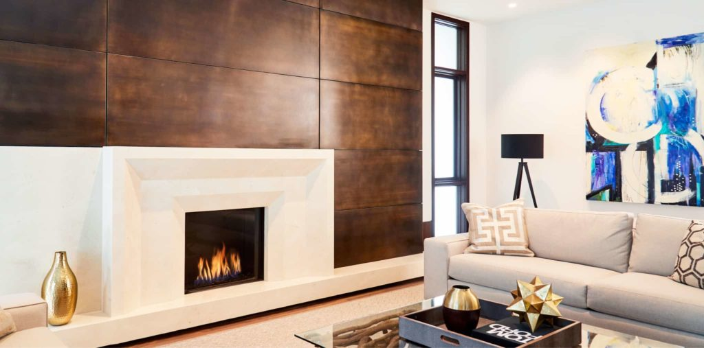 Front Facing Fireplace Surrounded by White Concrete