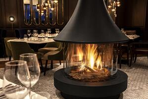 The Ortal Standalone 70 Fireplace graces the Choux Gras Restaurant